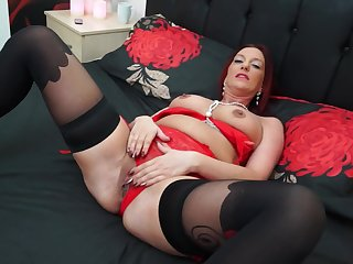 Redhead MILF Francesca makes herself cum with a dildo in their way pussy