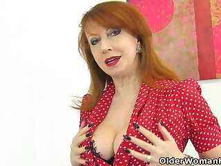 English milf Red probes the brush fanny with one fingers