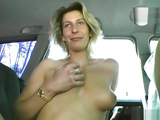 Blonde MILF gets dildo fucked in the car