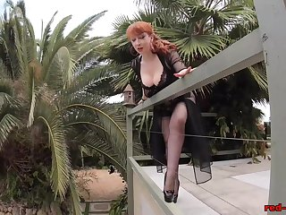Mature Red XXX teasing outside on the patio