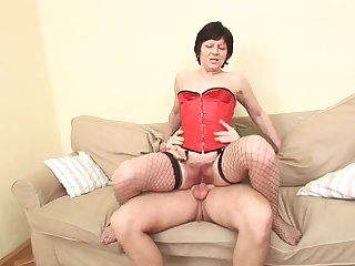 Old whore in a sexy corset bounces her high horse dick