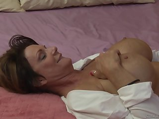 Blonde mature lesbians Dana DeArmond increased by Deauxma on the bed
