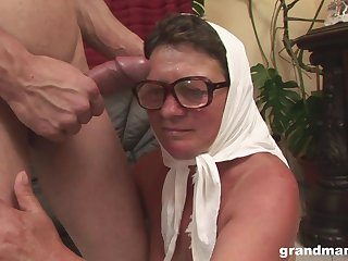 Granny blows and rides a younger guy and gets cum on their way glasses