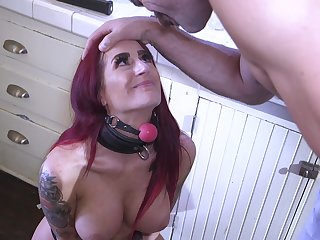 Long haired redhead Tana Lea strapped to a writing-desk and doggy fucked