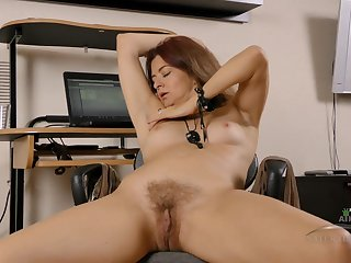 Playful shrivelled mature Helen masturbates down her office