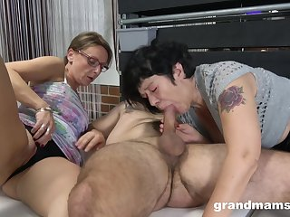 Two mature grannies love to compete in giving blowjobs to a stud