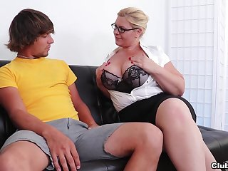 Busty blonde of age with glasses loves to awe her younger man