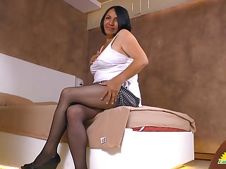 Obese old Latin whore Andrea shows off cleavage and panties upskirt